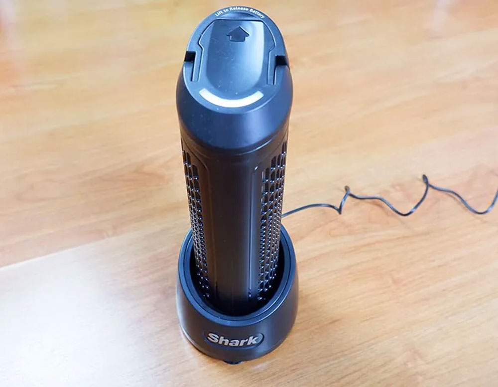 Shark ION P50's battery on its charging dock.